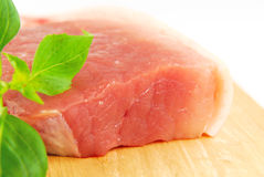 Fresh pork meat on a cutting board. On white background Stock Photos