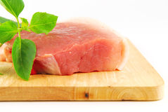 Fresh pork meat on a cutting board. On white background Royalty Free Stock Photos