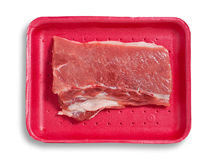 Fresh pork meat isolated. Fresh pork meat on a plastic tray. Isolated, white background, clipping path excludes the shadow Stock Images
