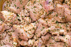 Fresh pork meat pieces in marinade. Royalty Free Stock Photography