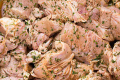 Fresh pork meat pieces in marinade. Royalty Free Stock Image