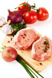 Fresh pork meat steaks with vegetables Royalty Free Stock Image