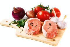 Fresh pork meat steaks with vegetables Stock Photo