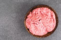 Fresh pork minced in wooden bowl. Studio Photo Stock Image