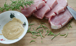 Fresh pork with mustard Royalty Free Stock Images