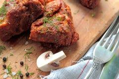 Fresh pork ribs. Pork ribs with mushrooms, garlic and fresh herbs Royalty Free Stock Image