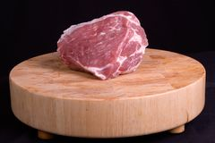 Fresh Pork Roast. Close up still capture of a fresh pork roast on a hardwood cutting board Stock Photography