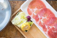 Fresh pork slices and fresh vegetables. With ingredients for cooking shabu shabu and Sukiyaki Japanese food , Recommended dishes in Asian cuisine Royalty Free Stock Images