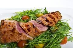 Fresh pork steak with salad. Pork steak with fresh salad Royalty Free Stock Photo