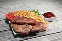 Pork steak on a plate Royalty Free Stock Images