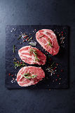 Fresh pork steaks with spices and rosemary Stock Image