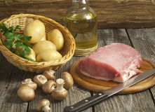 Fresh pork tenderloin with mushrooms and potatoes Royalty Free Stock Photo