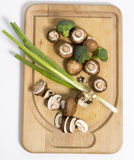 Fresh portabello mushrooms on the cutting board Stock Images