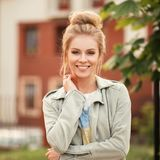 Fresh portrait of a beautiful happy young model girl. In a fashionable jacket outdoor royalty free stock photos