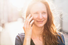 Fresh Portrait of a Woman on the Phone Stock Images