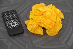 Fresh Potato Chips with TV Remote Control Royalty Free Stock Photo