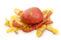 Fresh potato and peels Stock Images