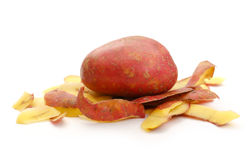 Fresh potato and peels Royalty Free Stock Image