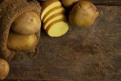Fresh Potato in sack Stock Photo
