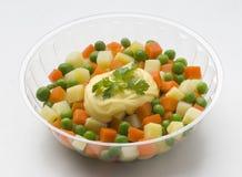 Fresh potato salad. With carrots and peas Royalty Free Stock Image