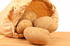 Fresh potatoes in a brown paper bag Stock Images