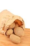 Fresh potatoes in a brown paper bag Stock Photos