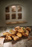 Fresh potatoes in a country kitchen Stock Photos