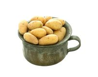 Fresh potatoes in metal bowl isolated on white Stock Photography