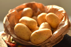 Fresh potatoes in a paper bag Royalty Free Stock Photos