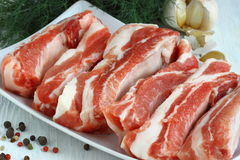 Fresh potk ribs. Uncooked Pork ribs with raw meat on a plate Shallow DOF royalty free stock photo