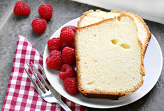 Fresh pound cake and raspberries. Royalty Free Stock Photography