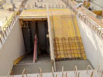 Staircase with rebar iron on construction site. Fresh poured concrete on staircase with rebar iron and shawl panels on construction site Stock Photo