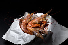 Fresh prawn. Just bought in the market on a black stone. Free space on top Royalty Free Stock Images