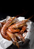 Fresh prawn in the kitchen. Free space on top. Fresh prawn just bought in the market on a black stone. Free space on top Stock Image