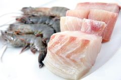 Fresh prawns and fish meat royalty free stock images