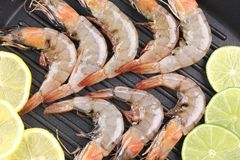 Fresh prawns with lemon slices. Royalty Free Stock Photography