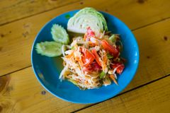 Thai Som Tam papaya salad. Fresh prepared asian spicy Som Tam papaya salad with cabbage and cucumber served in local restaurant on Koh Mook island. Traditional royalty free stock images