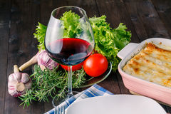 Fresh prepared lasagne with ingredients on table Stock Photography