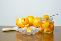 Fresh and preserved oranges Stock Image