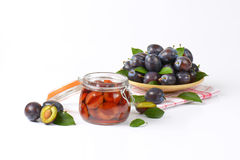 Fresh and preserved plums Royalty Free Stock Photography