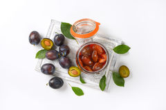 Fresh and preserved plums Royalty Free Stock Images