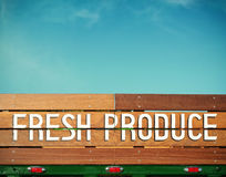 Fresh Produce. Hand painted wooden sign on a vintage green truck with room for your own message stock images