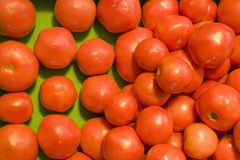 Fresh produce. Pile of red tomatoes at produce market Royalty Free Stock Photography