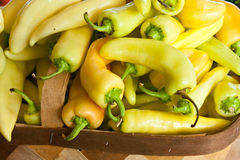 Fresh Produce Banana Peppers. Fresh banana peppers stacked at a produce market Royalty Free Stock Image