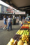 Fresh produce with shoppers at Pike Place Public Farmers Market, Seattle, WA Royalty Free Stock Images