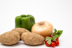 Fresh produce staged on a white background. Broccoli tomato onion stock photography