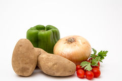 Fresh produce staged on a white background. Broccoli tomato onion stock image