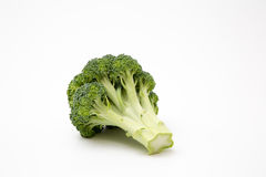 Fresh produce staged on a white background. Broccoli tomato onion garlic royalty free stock photo