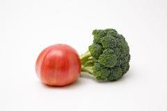 Fresh produce staged on a white background. Broccoli tomato onion garlic royalty free stock photography