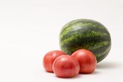 Fresh produce staged on a white background. Broccoli tomato onion garlic stock image